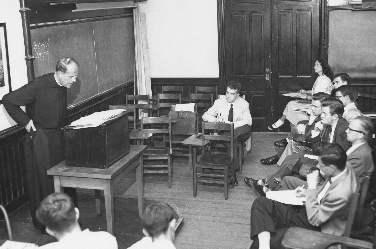 Lone female sitting in class with Father Frank Fadner