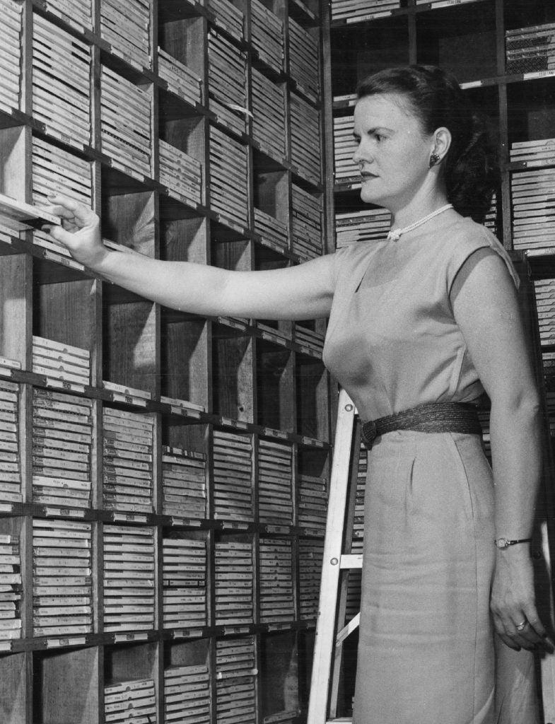 Female student arranges audio tapes