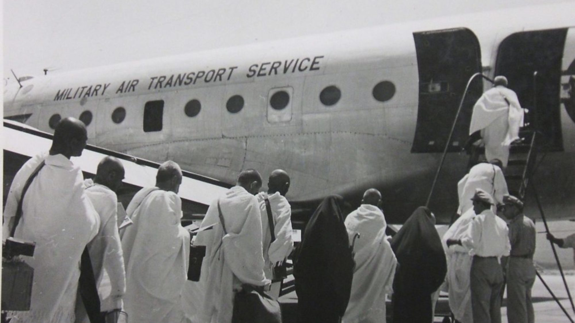 Men boarding military air transport plane