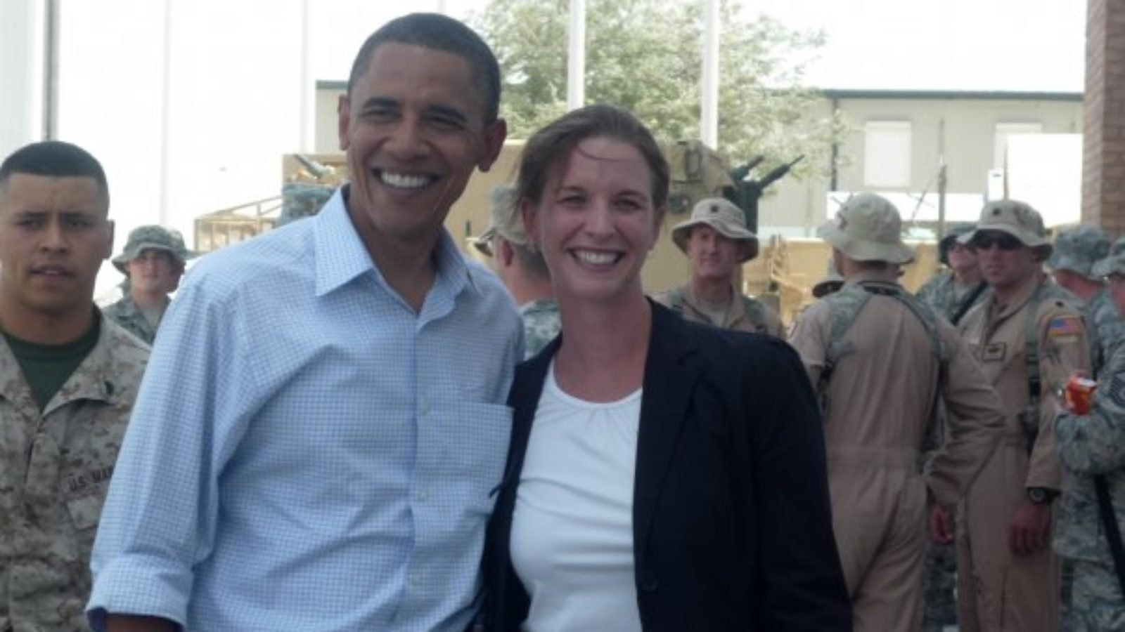Bailey Hand with President Obama. Military in background