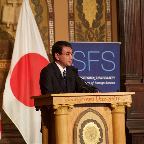 Foreign Minister of Japan speaking at podium of Gatson Hall