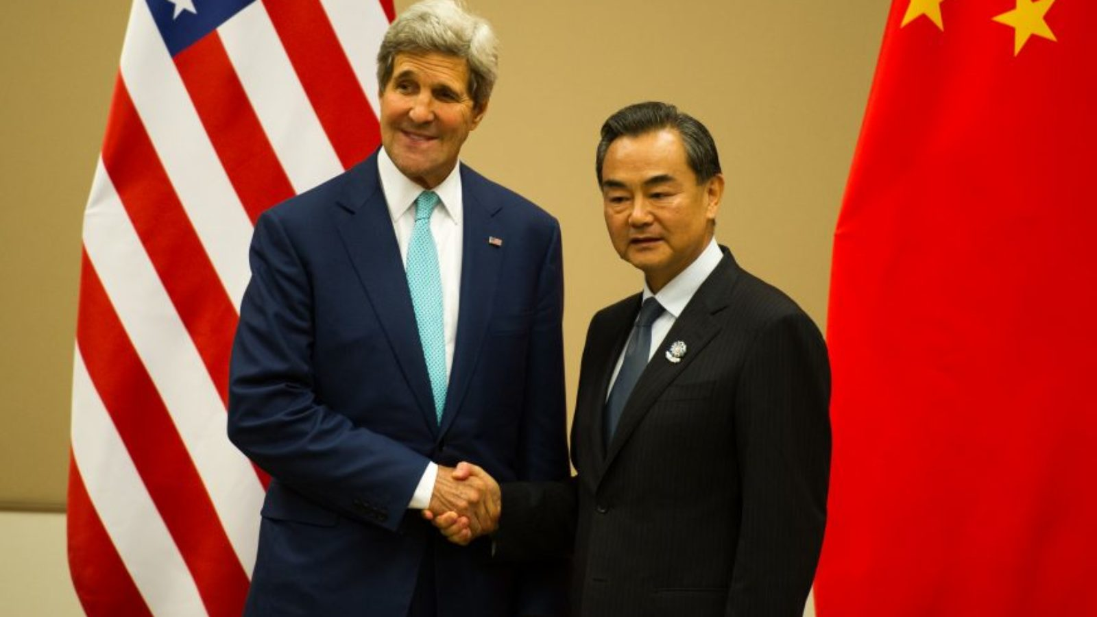 John Kerry and Wang Yi shaking hands