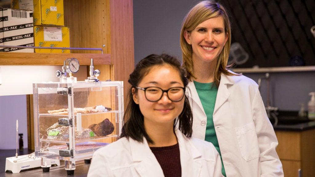 Professor Sarah Johnson and student in lab coats