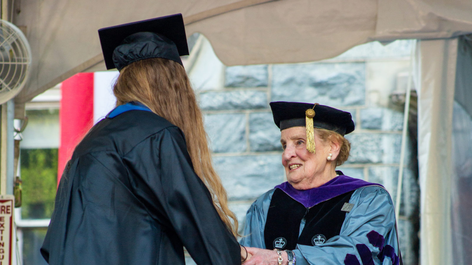 Graduate shaking hands with Madeleine Albright