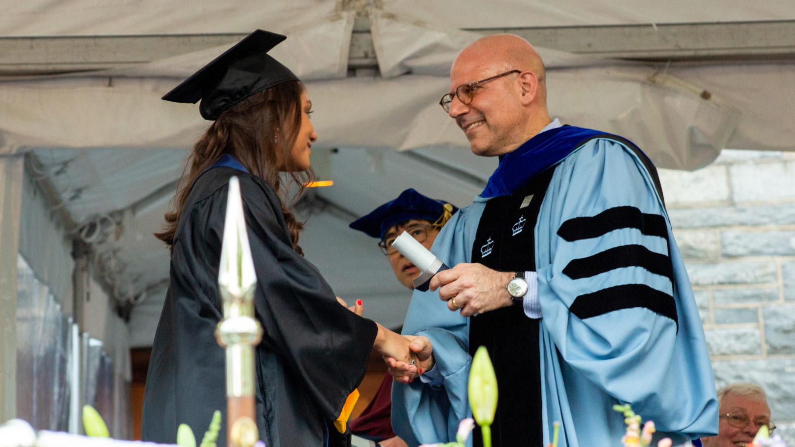 Dean Helman handing degree to student