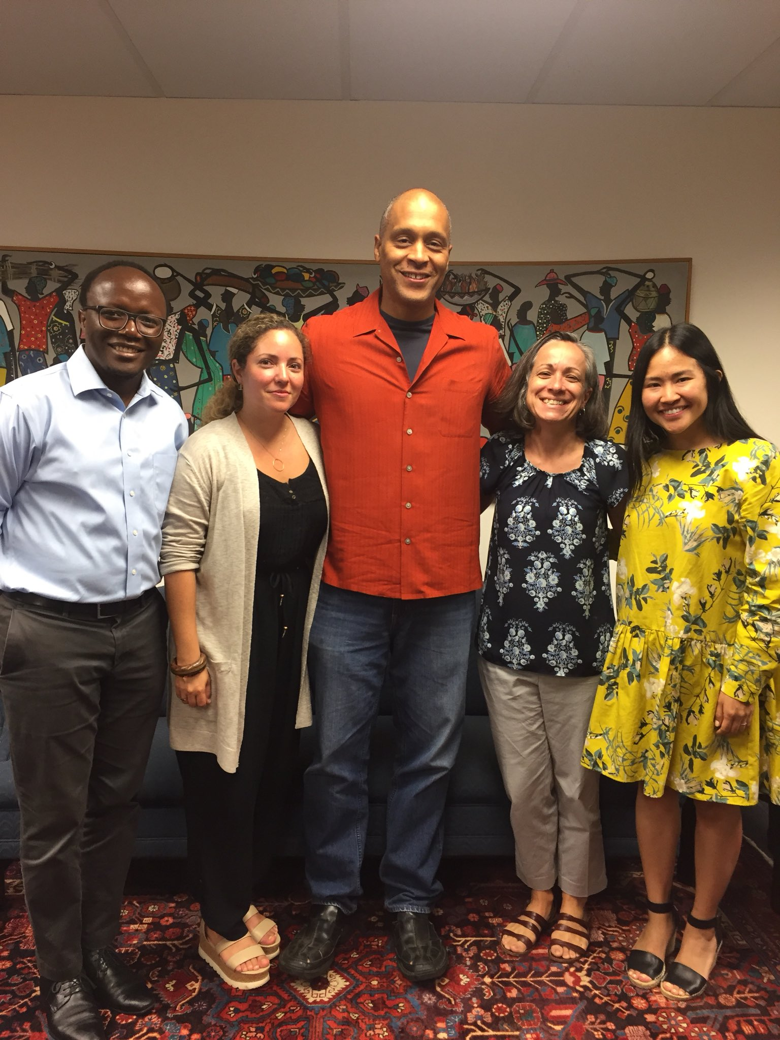 Smith surrounded by African Studies Program faculty and staff, including former Director, Prof. Scott Taylor.