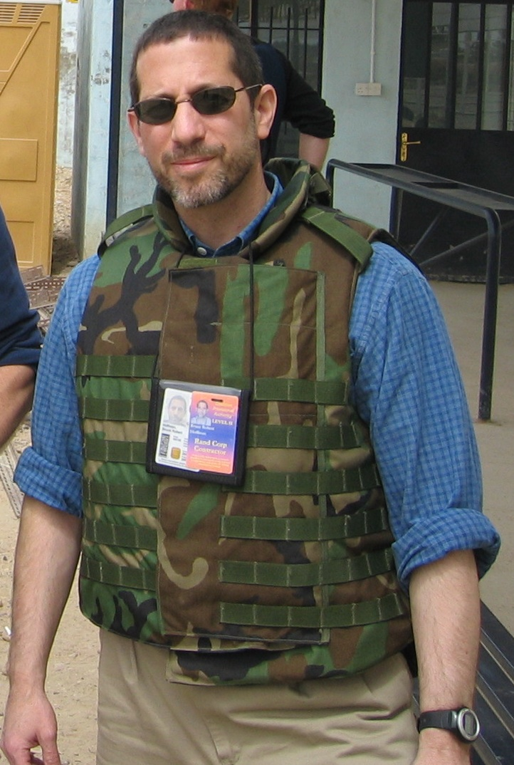 Prof. Hoffman wears his credentials and a camouflage bulletproof vest.