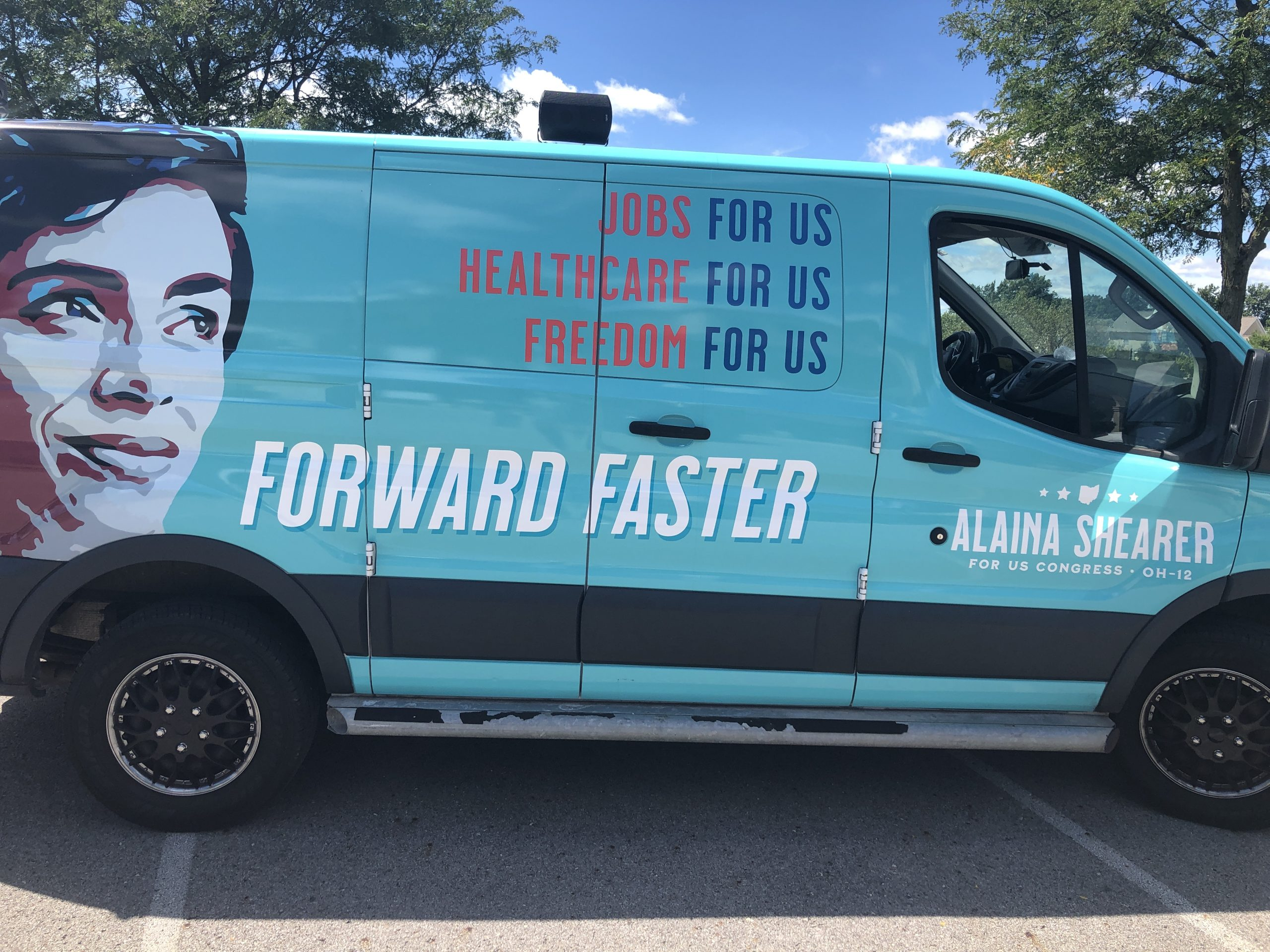 """Shearer for Congress van imprinted with text: """"Jobs for us. Healthcare for us. Freedom for us. Forward faster."""""""