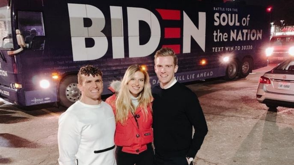 """Sophia Sokolowski and classmate Thomas Hanley are pictured with another campaign staffer in front of a Biden """"Soul of the Nation"""" campaign bus."""