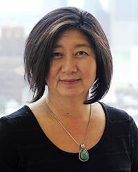 Profile photo of Yoon Jung Park. She is wearing a black shirt and a pendant necklace.