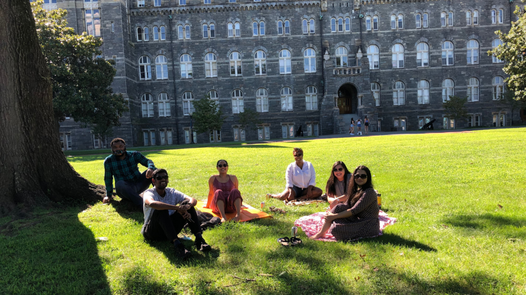 Jimmy pictured with friends sitting, socially distanced, on Healy Lawn.