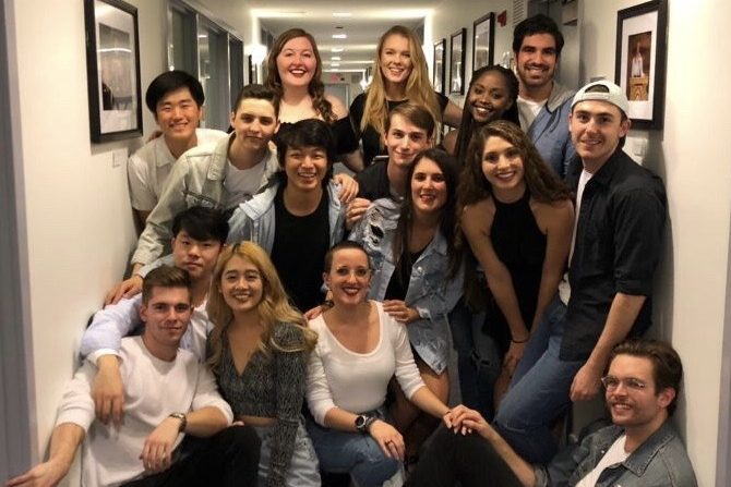 Group photo of students in Georgetown Supergood. They are backstage after a performance.