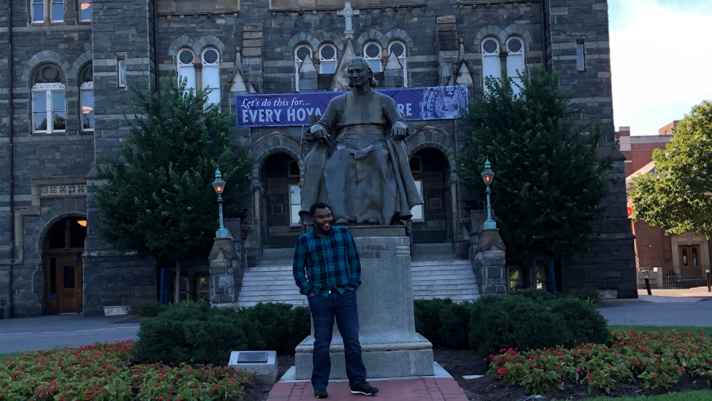 Jimmy stands in front of the John Carrol statue on Georgetown's campus.