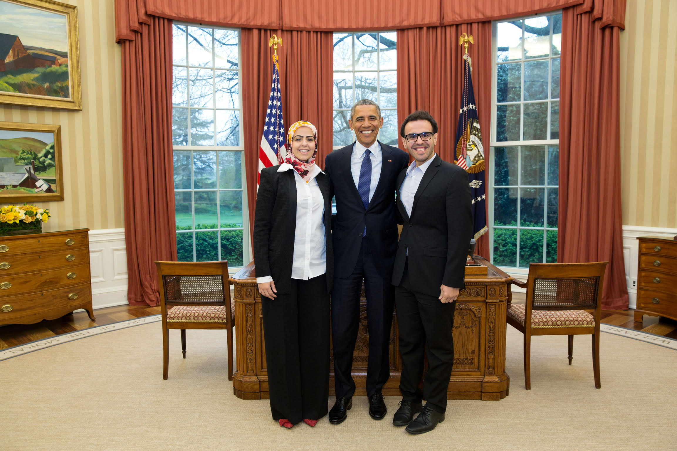 Soltan poses for a photo in the Oval Office with then-U.S. President Barack Obama