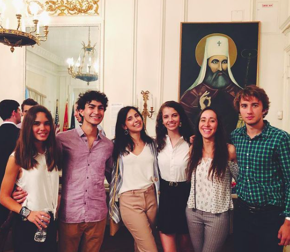 Daly and five friends pose at a European embassy event.