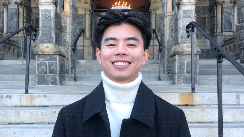 Shing Aung profile photo in front of Healy Hall steps