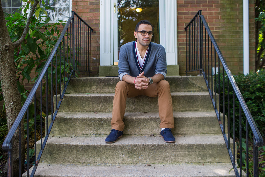 Soltan sits on the steps of his home in Fairfax, Virginia