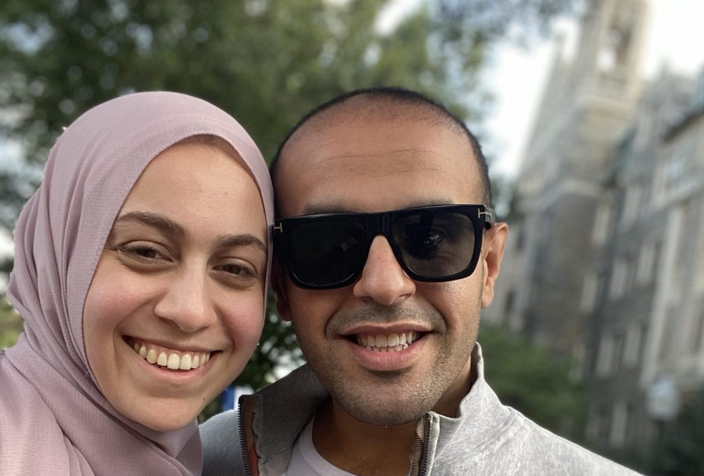 Soltan and his wife, Habiba Shebita, take a selfie in front of Healy Hall