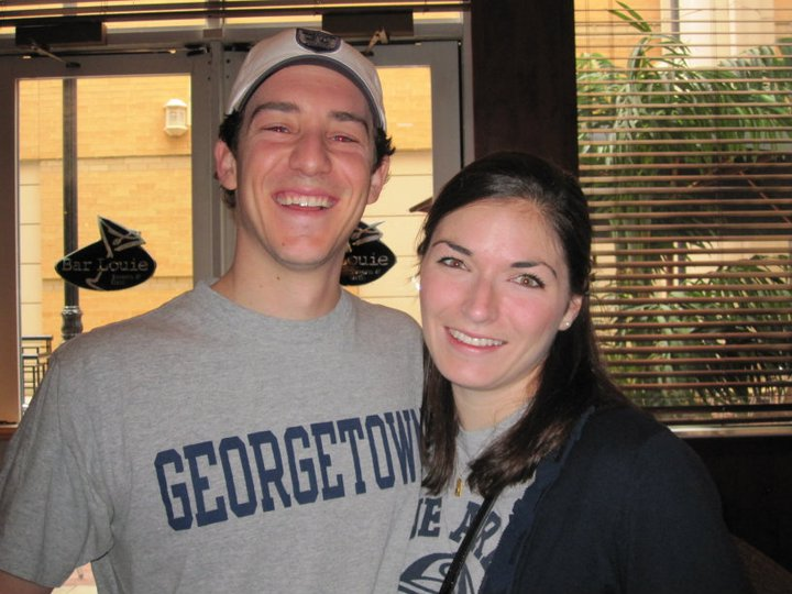 Kessler and his wife, Nicole, take a picture together as college students wearing Georgetown gear.