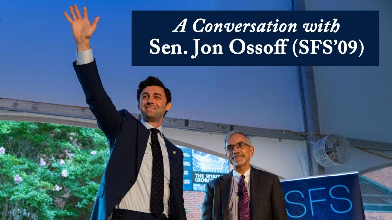 Ossoff waves to an audience in Georgetown's Red Square. Banner text reads: