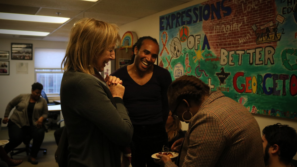 Teak Hodge (SFS'21) laughs with visitors to Georgetown's LGBTQ Resource Center