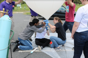 Laura Ratliff working on the high altitude balloon.