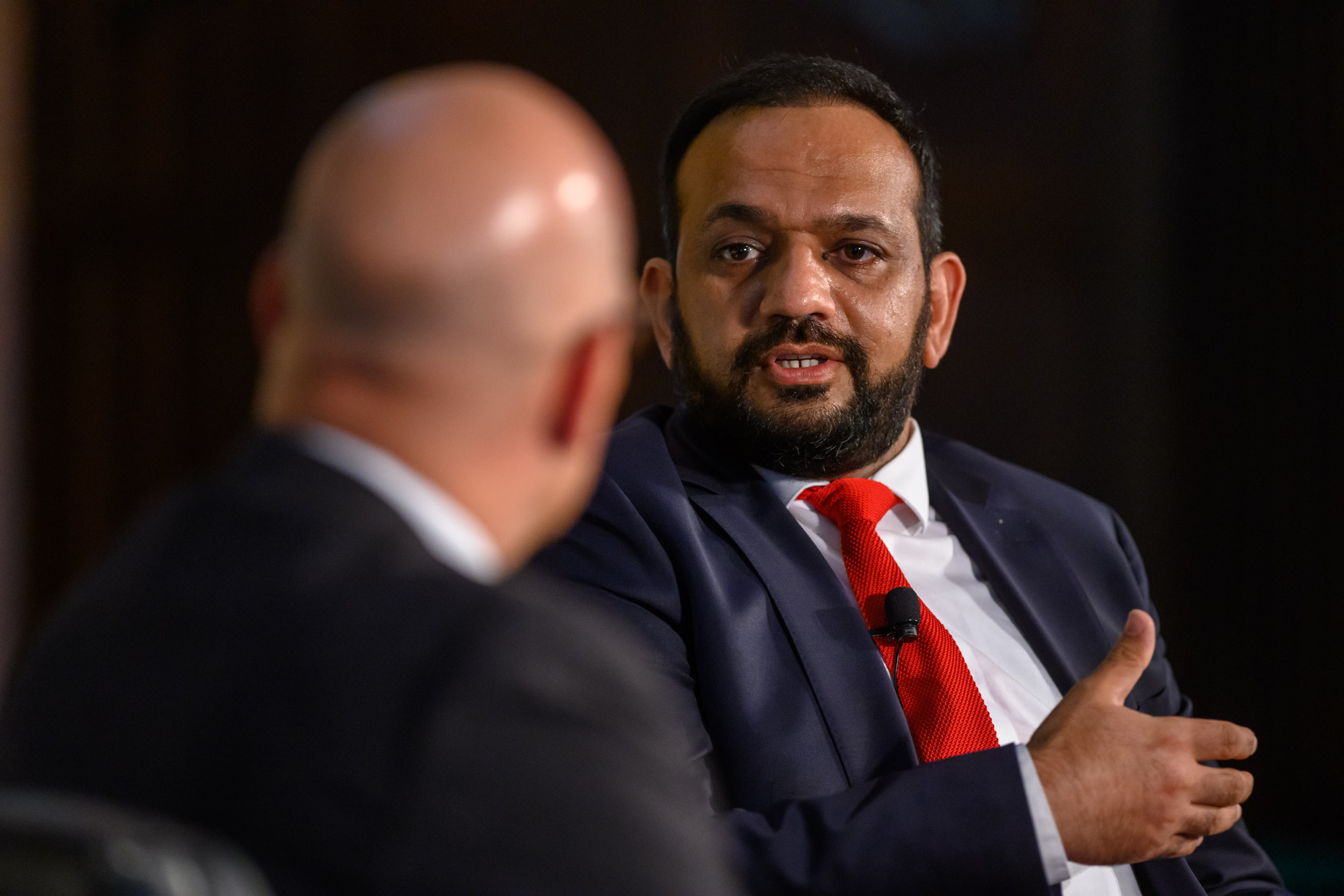 Former Afghan Finance Minister Khalid Payenda, wearing a white shirt and red tie, faces SFS Dean Joel Hellman
